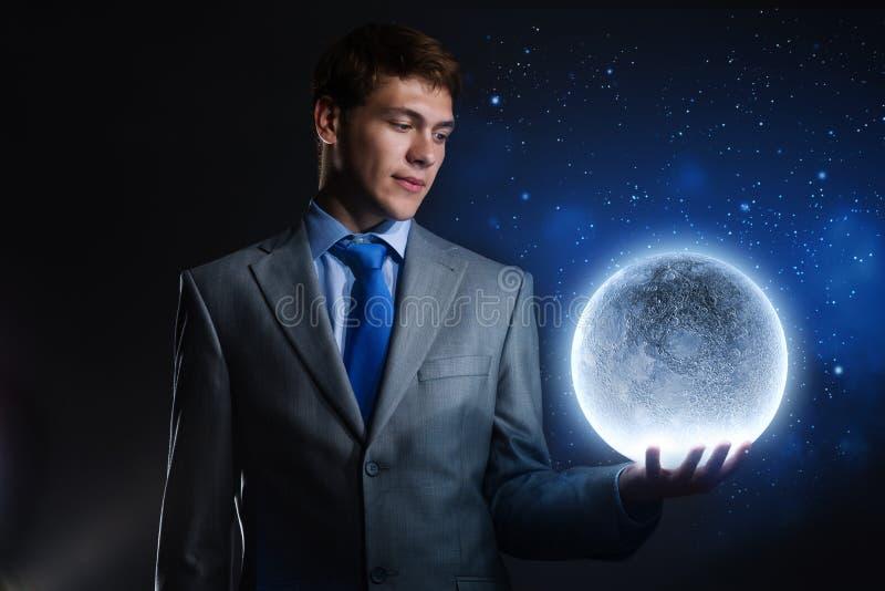 Download Бизнесмен с луной стоковое изображение. изображение насчитывающей красиво - 41650733