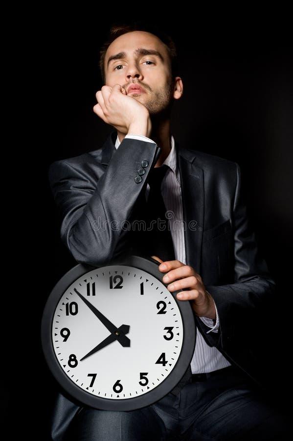 Бизнесмен с часами стоковые изображения rf