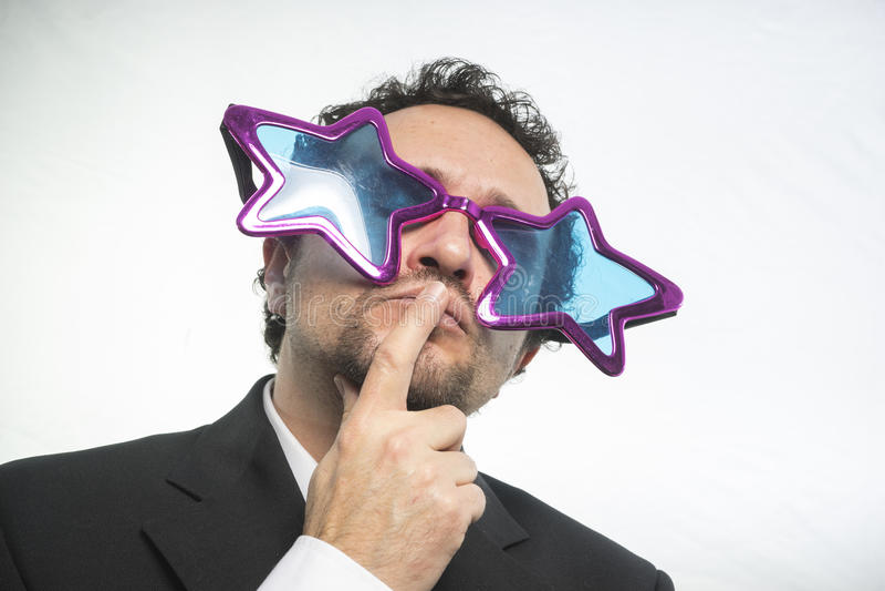 Бизнесмен с achiever звезд стекел, шальных и смешного стоковые изображения rf