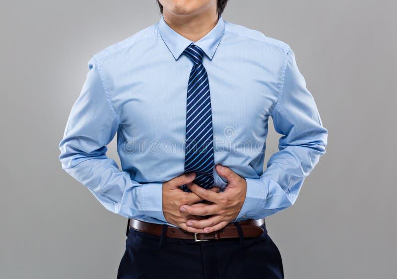 Бизнесмен с stomachache стоковые фотографии rf