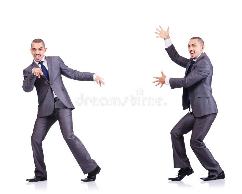 Бизнесмен танцев изолированный на белизне стоковое изображение