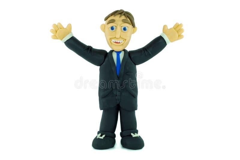 Бизнесмен успеха усмехаясь в пластилине стоковое изображение rf
