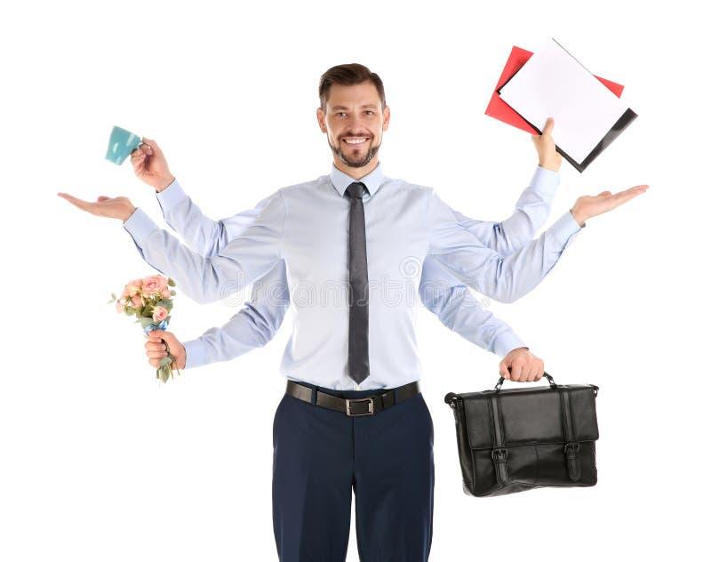 Бизнесмен Multitask с много рук держа различное вещество на белой предпосылке стоковая фотография