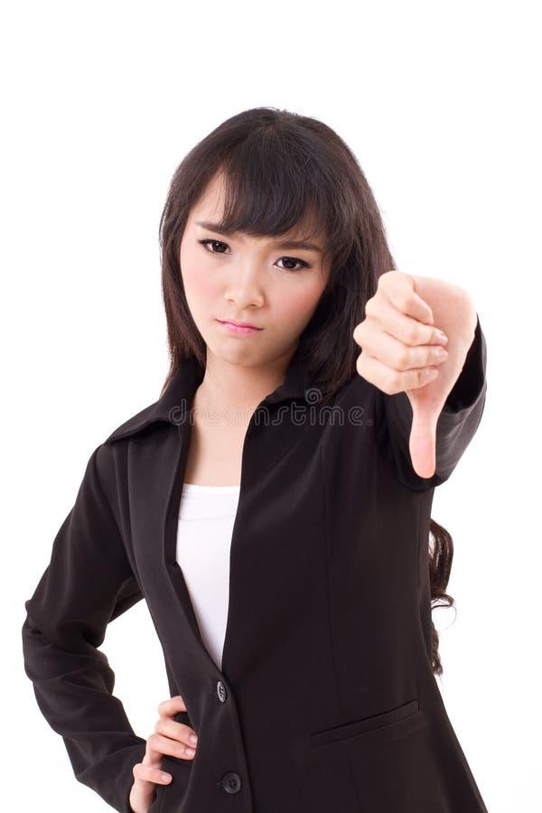 Бизнес-леди давая большой палец руки вниз стоковое изображение