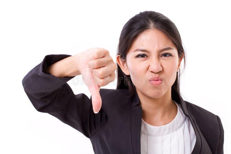 Бизнес-леди давая большой палец руки вниз стоковая фотография rf