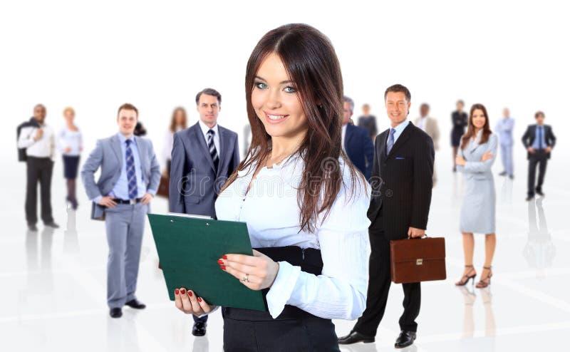Бизнес-леди водя ее изолированную команду стоковая фотография rf
