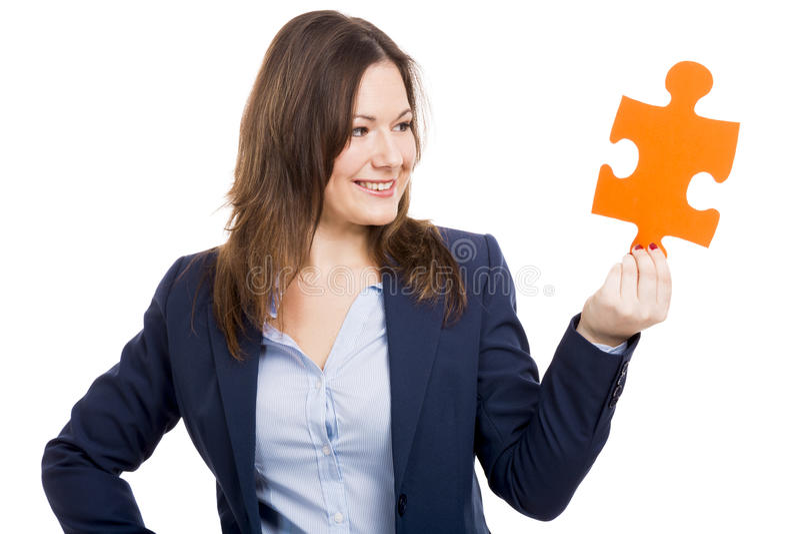 Бизнес-леди держа часть головоломки стоковое изображение rf