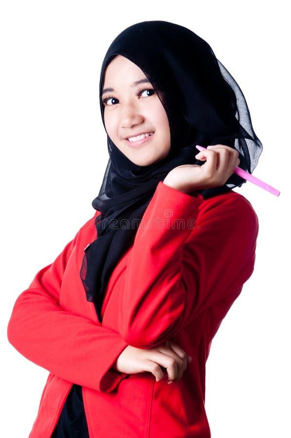 Бизнес-леди держа шариковую авторучку стоковое фото rf