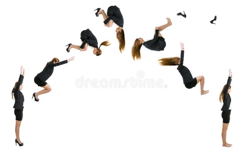 Бизнес-леди делая переднее сальто стоковое фото rf