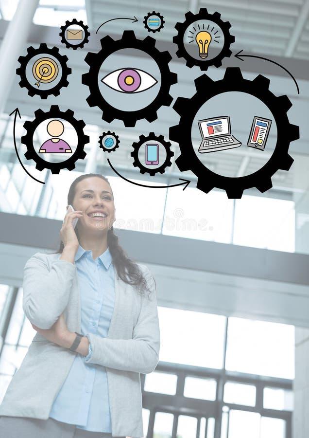 Бизнес-леди на телефоне с черными графиками шестерни и белым верхним слоем стоковое изображение