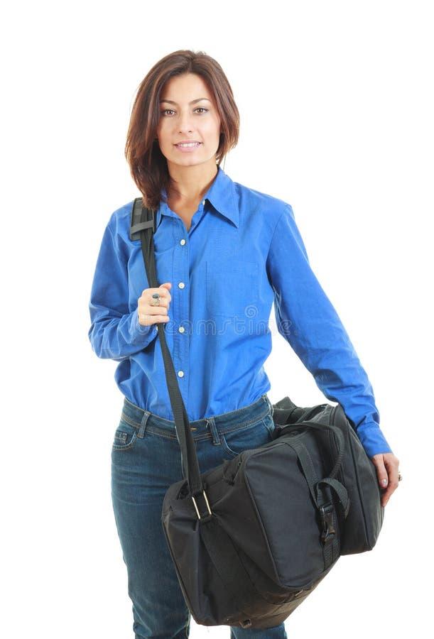 Бизнес-леди нося чемодан стоковое изображение rf