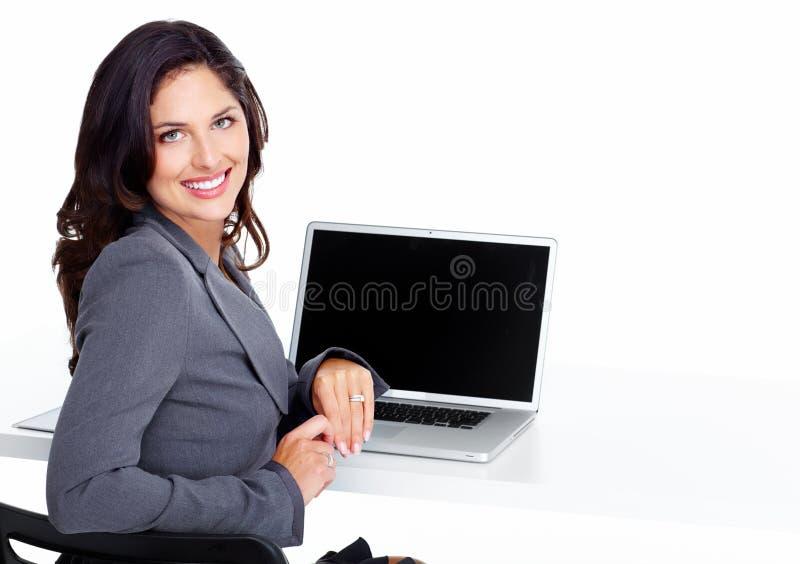 Бизнес-леди с портативным компьютером. стоковые изображения