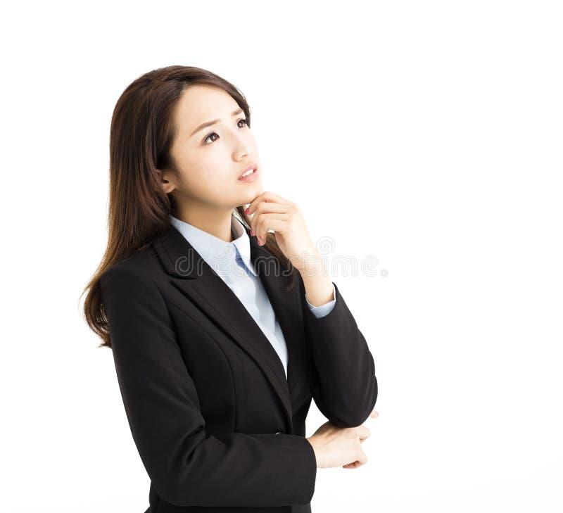 Бизнес-леди думая и смотря вверх стоковые изображения rf