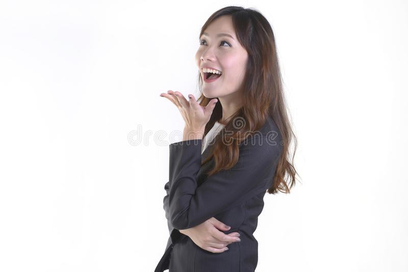 Бизнес-леди в улыбке делового костюма и возбуждать на чисто белой предпосылке стоковые изображения rf