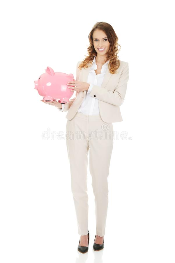 Бизнес-леди с piggybank стоковые изображения rf