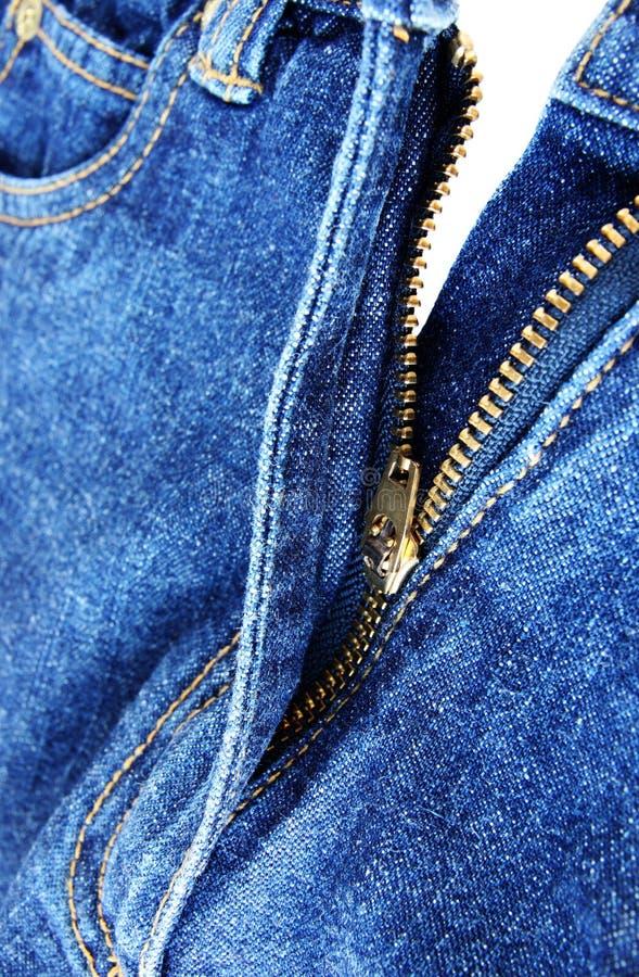 близкая джинсовая ткань вверх по застежке -молнии стоковые изображения