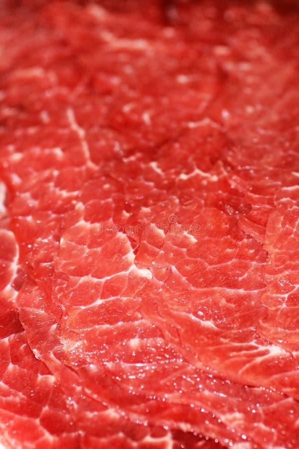 близкий красный цвет мяса вверх по вертикали стоковые фото
