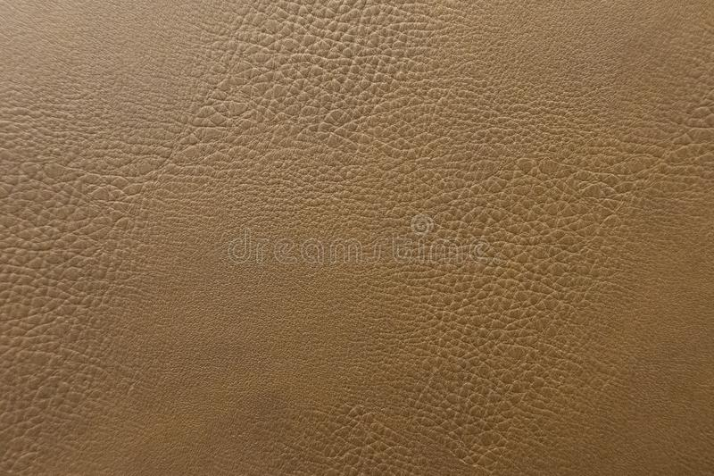 Близкий поднимающий вверх фон коричневого цвета кожаного дивана, текстура предпосылки стоковая фотография rf
