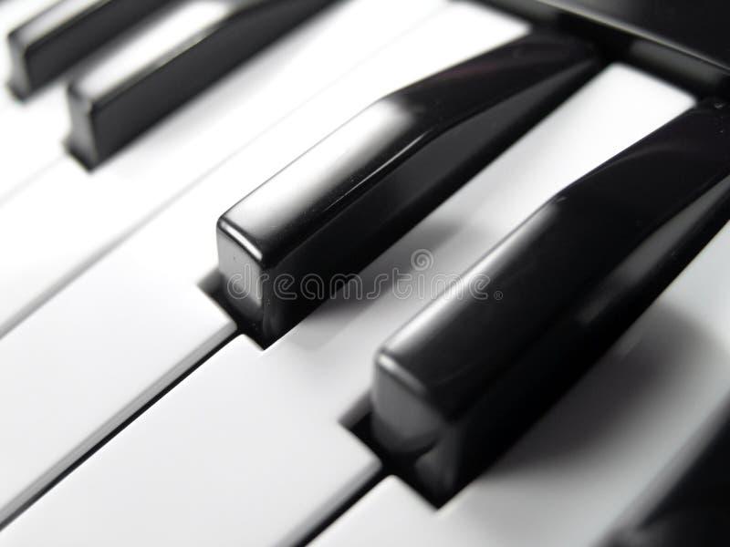близкий рояль клавиатуры вверх стоковое изображение