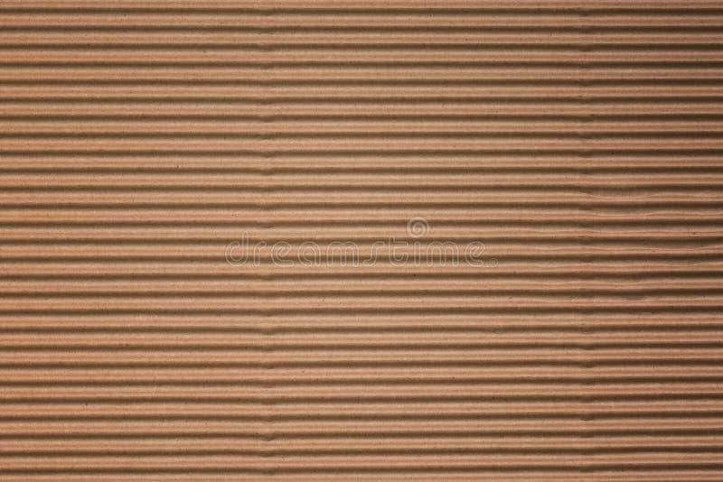 Близко вверх повторно используйте картон или коричневую предпосылку текстуры коробки бумаги kraft доски стоковое изображение rf