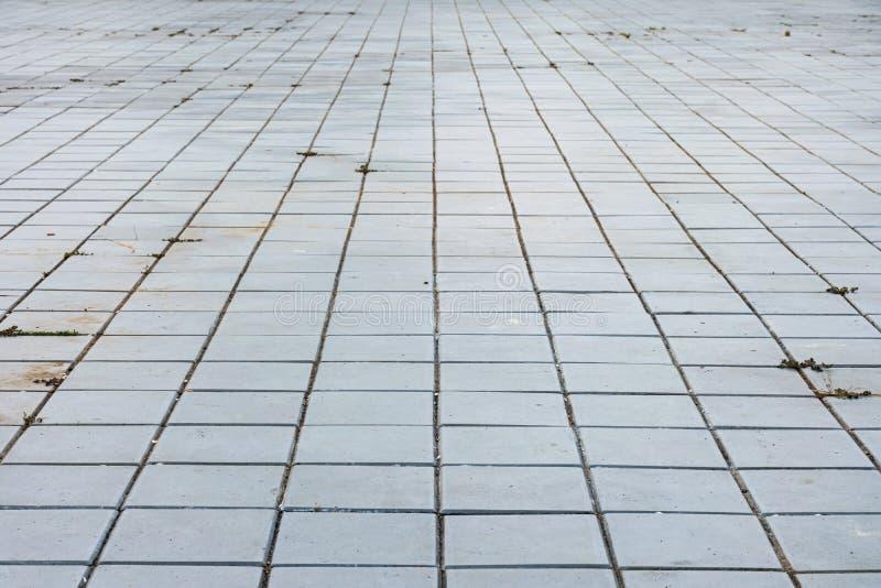 Блоки цемента вымощены на том основании стоковые фото