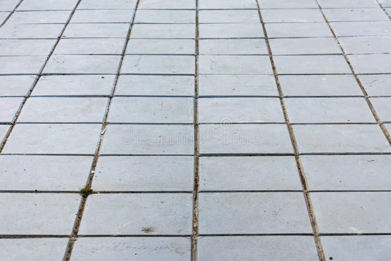 Блоки цемента вымощены на том основании стоковые изображения