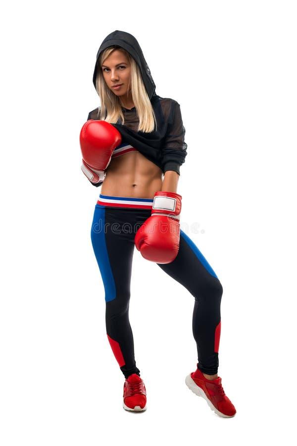 Блондинка в взгляде перчаток бокса изолированном стоковые изображения rf