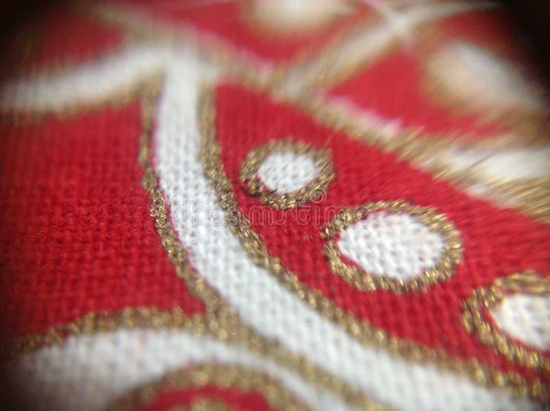 Богато украшенная ткань принятая с объективом макроса стоковое изображение rf