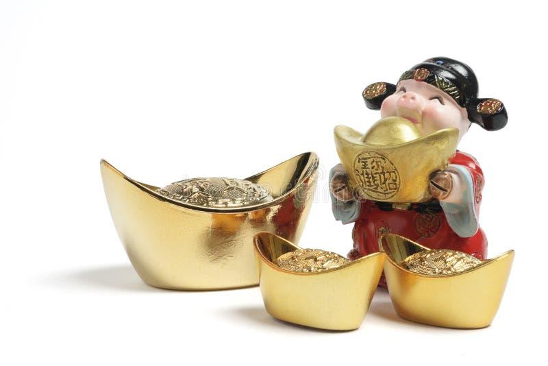 богатство золотых инготов бога figurine стоковая фотография