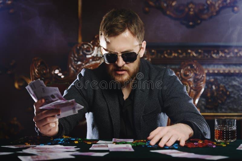 Богатый игрок казино стоковое изображение