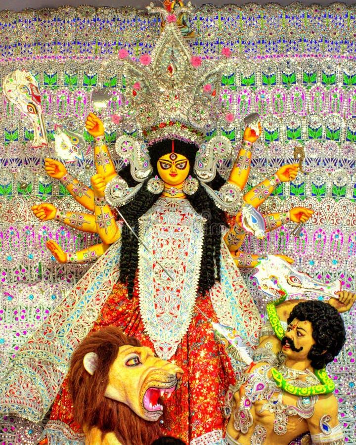 Богиня Durga сидя на льве стоковое изображение rf