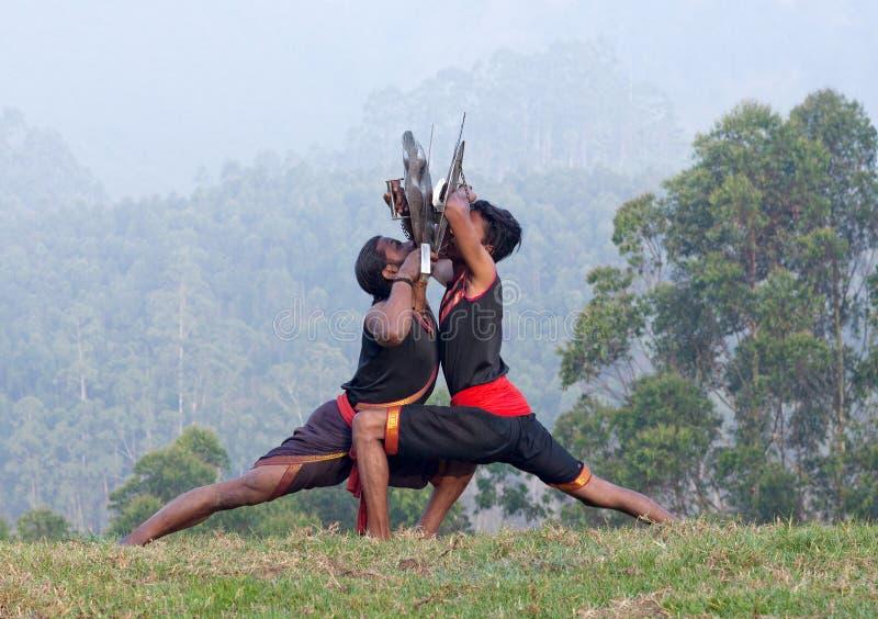 Боевые искусства Kalaripayattu в Керале, Индии стоковое изображение