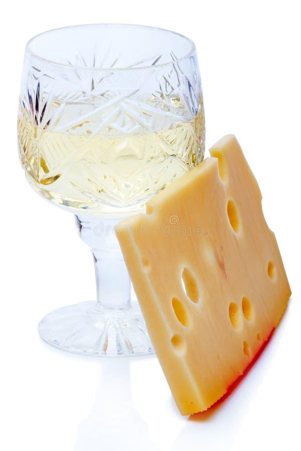 Бокал вина и часть сыра стоковое изображение rf