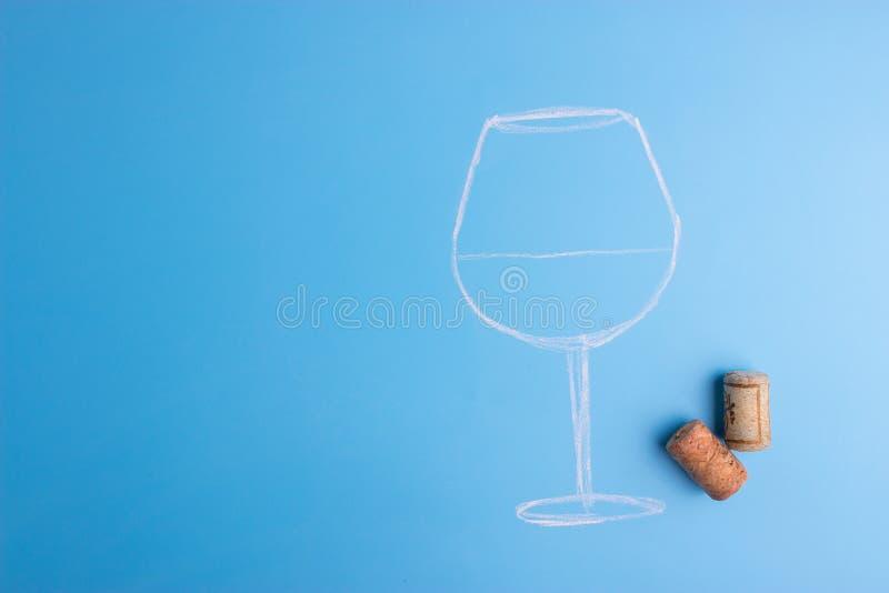 Бокал вина с штопором стоковые фото