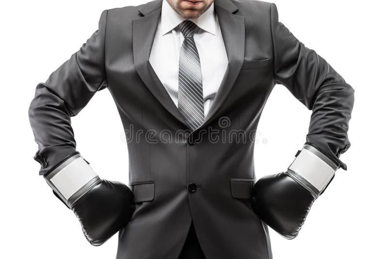 Боксер бизнесмена в перчатках бокса спорта черного костюма нося стоковое изображение