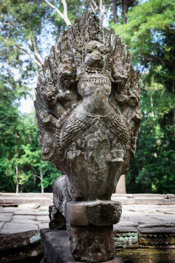 Более старая статуя Naga стоковое изображение rf