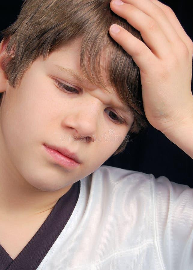больной мальчика унылый стоковое изображение rf