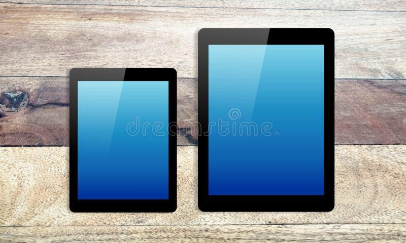 Большие компьютер и мини с изолированным текстурированным экраном на деревянном r иллюстрация штока
