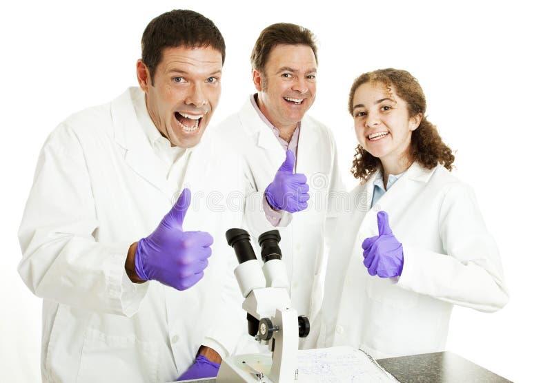большие пальцы руки науки вверх стоковая фотография rf