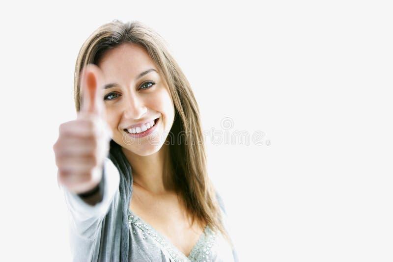 большие пальцы руки поднимают женщину стоковое изображение