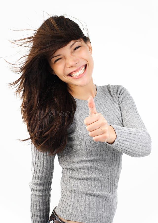 большие пальцы руки поднимают женщину стоковое фото