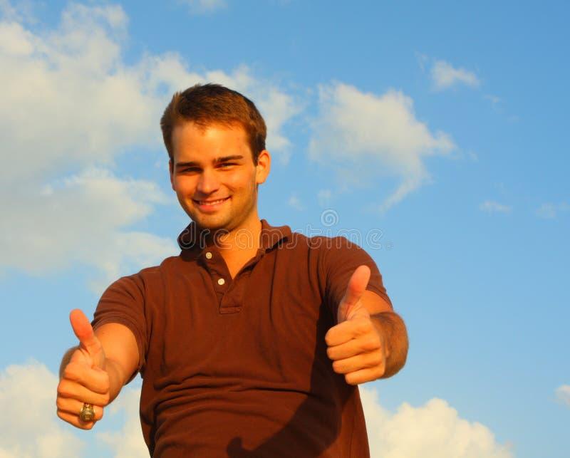 большие пальцы руки человека вверх стоковое изображение