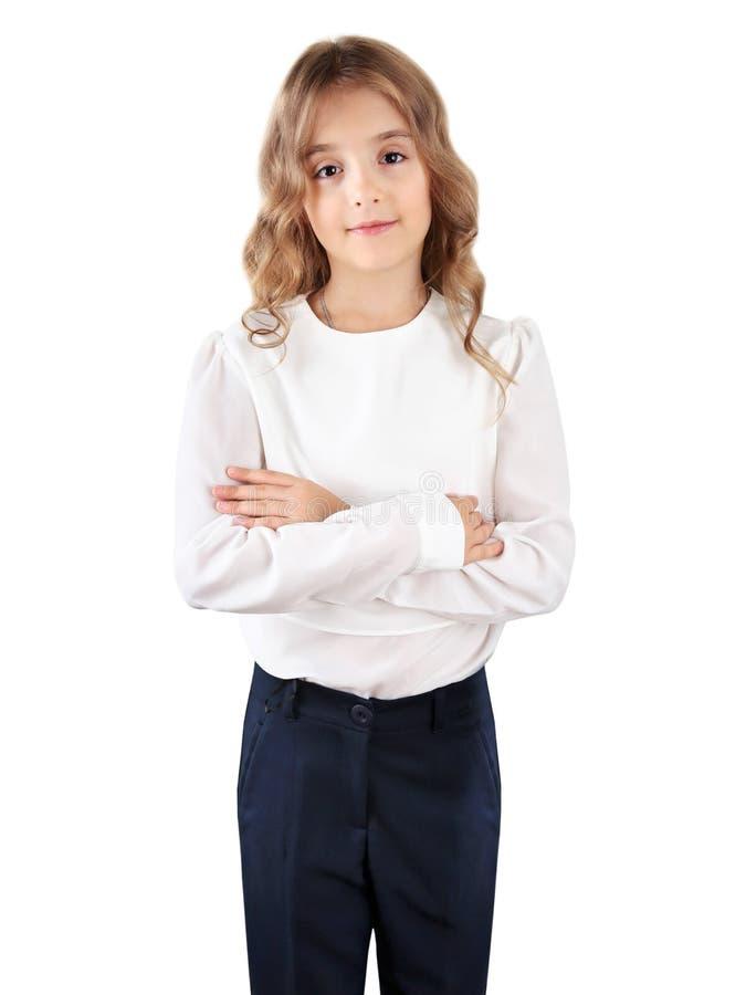 Большой изолированный ребенк, положение девушки школы стоковое изображение