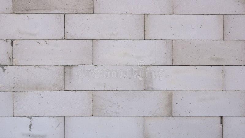 Большой конкретный блок конструкции изолированный на белой предпосылке стоковое изображение rf