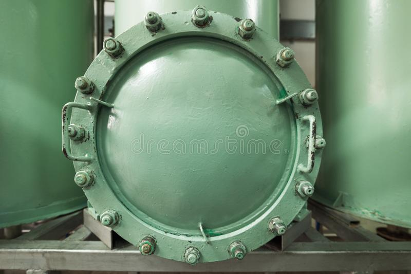 Большой, массивнейший люк осмотра в фильтре песка стоковое изображение