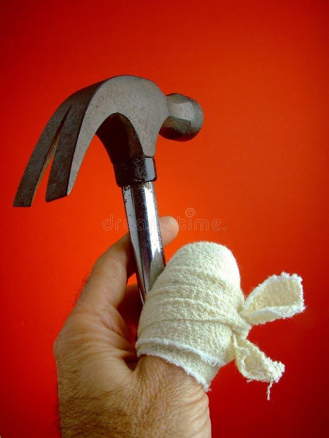 большой пец руки болячки молотка стоковое фото rf