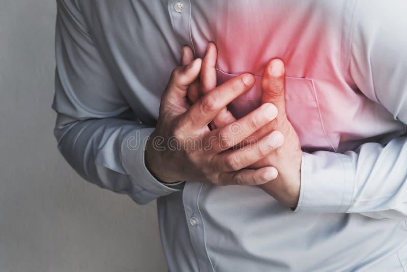 боль в груди людей от сердечного приступа Здравоохранение стоковое изображение rf