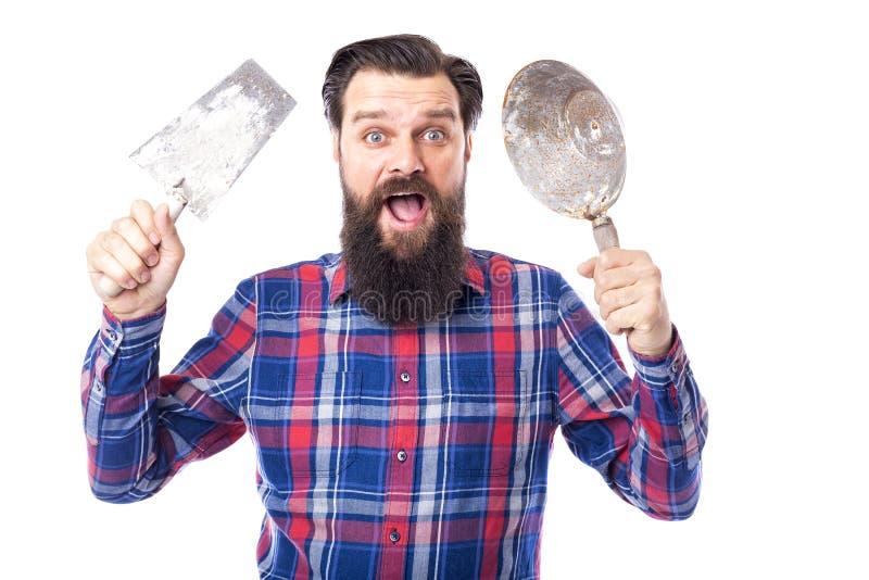 Бородатое удерживание человека использовало инструменты masonry стоковая фотография rf