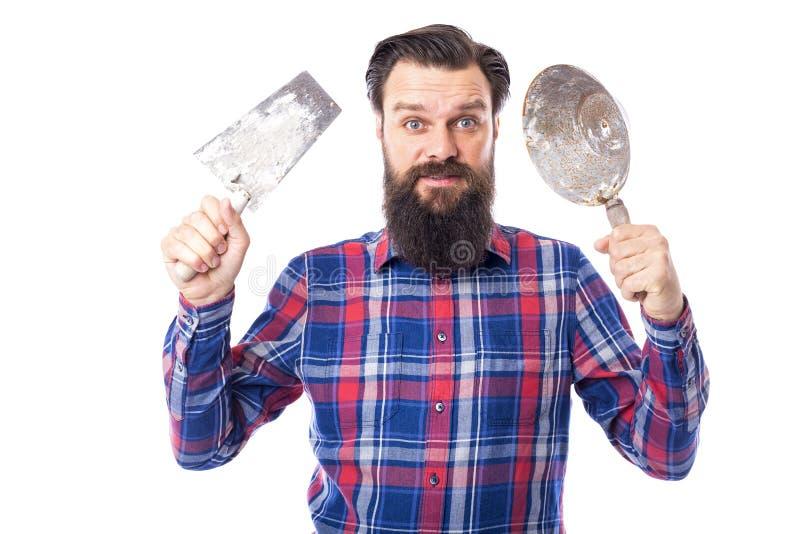 Бородатое удерживание человека использовало инструменты masonry стоковое фото