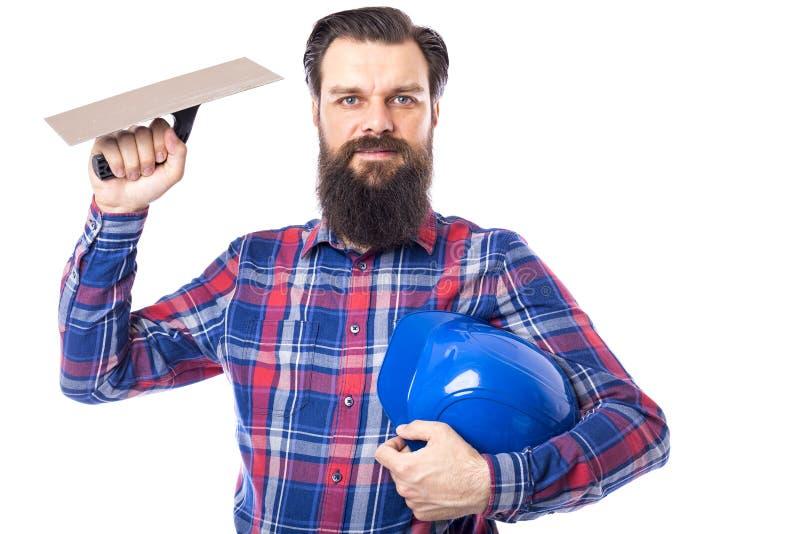 Бородатым инструмент masonry человека используемый удерживанием стоковое изображение rf